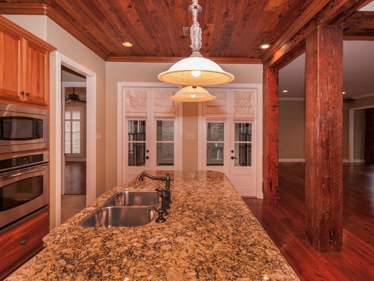 The custom kitchen has top of the line appliances and granite counter tops.