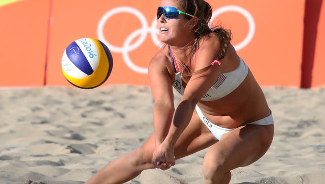 United States right defender Brooke Sweat (2) of Fort Myers dives for a ball in a women's preliminary - Pool A match  against Russia at the Beach Volleyball Arena during the Rio 2016 Summer Olympic Games on Thursday, Aug. 9, 2016, in Rio de Janeiro, Brazil.