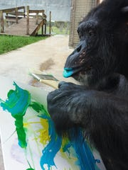 Pepsi likes to use a combination of paint brush and his lips when creating his masterpieces.