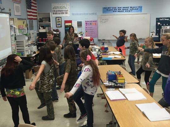 Students in Tara Page's fourth-grade class take a break