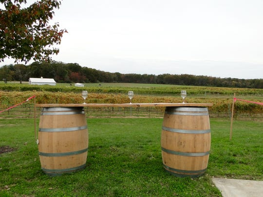 A makeshift tasting bar is set up Wednesday in the place where the new tasting bar of Sharrott Winery will be. Large windows will allow tasters to look out at the vineyard.