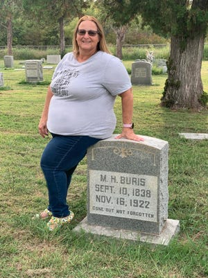 Greenleaf Cemetery volunteer, Jeannette Buris is pictured with the headstone of her husband's third great-grandfather, who was a Civil War veteran. Buris and other Greenleaf supporters hope to place Christmas wreaths on each veteran's grave at the historic cemetery.