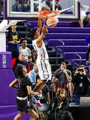 University School Trey Doomes dunks the ball then celebrates with his teammates. University School celebrated a win over Memphis East in the City of Palms Classic Championship game Saturday, December 23, 2017.