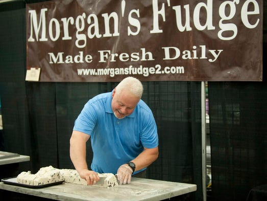 Eric Morgan of Morgan's Fudge of Gaylord, Michigan, makes Cookies and Cream fudge at the Kentucky Flea Market 4th of July Spectacular in the Kentucky Exposition Center's south wing. He's been making fudge for 35 years. 05 July 2014