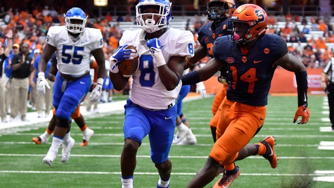 MTSU wide receiver Ty Lee (8) scores a touchdown as Syracuse defensive back Evan Foster (14) pursues during the second quarter Sept. 9, 2017, at the Carrier Dome.