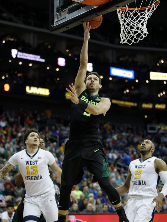 Baylor's Jake Lindsey (3) puts up a shot during the first half of an NCAA college basketball game against West Virginia in the Big 12 men's tournament Thursday, March 8, 2018, in Kansas City, Mo. (AP Photo/Charlie Riedel)