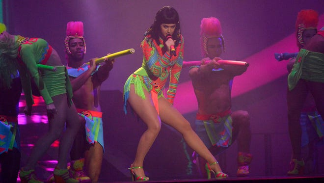 Singer Katy Perry performs at the BRIT Awards, celebrating British pop music, at the O2 Arena in London in this February 19, 2014 file photo. There is a strong chance of a neon-colored spectacle, perhaps some flying and definitely songs of female empowerment when pop singer Katy Perry takes the stage during halftime at the Super Bowl, the most-watched 12 minutes on U.S. Television.