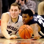 Gonzaga forward Kyle Wiltjer, left, fights for the ball against BYU's Anson Winder during their game Saturday. The Bulldogs lost just their second game of the season.