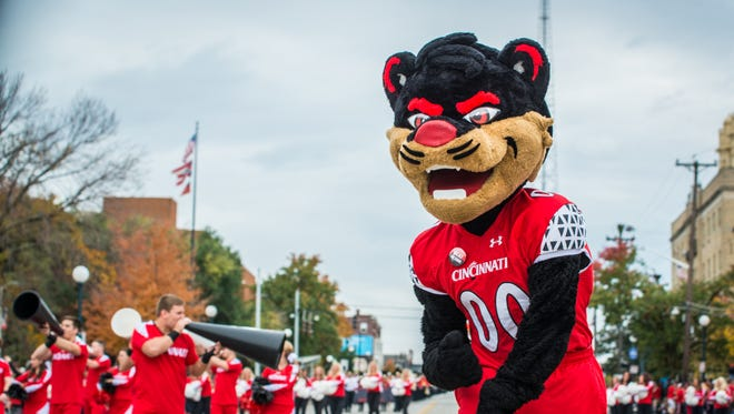 The Bearcat mascot pumps up the fans lined up along Clifton Avenue Saturday afternoon during the University of Cincinnati Homecoming Parade.
