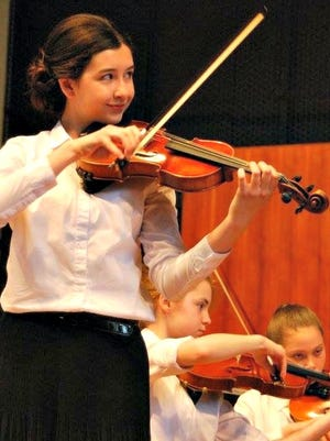 Cecelia Santiago, 13, of West Allis competes at a Milwaukee Youth Orchestra competition.