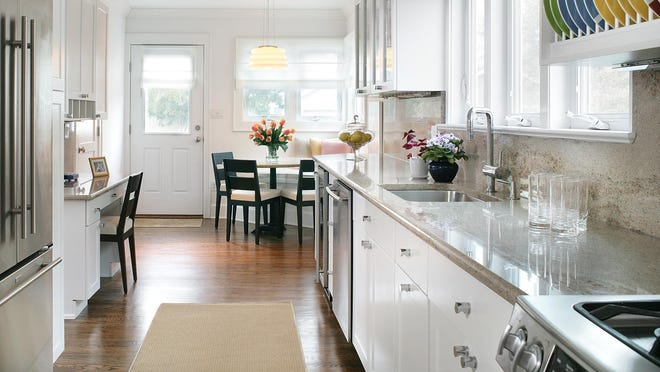 This beach house has a corner dining nook leaving an open path and a clear line of sight into the house from the back door to accommodate multigenerational weekend guests. The newly created eating area has a banquette as well as chairs for ease of use.