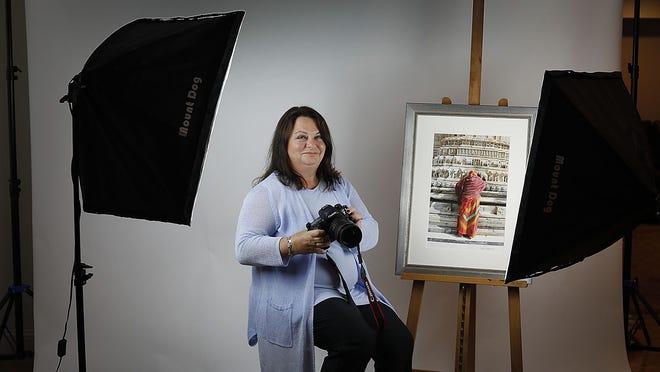 Plymouth photographer, Debi Cramer, in her studio.