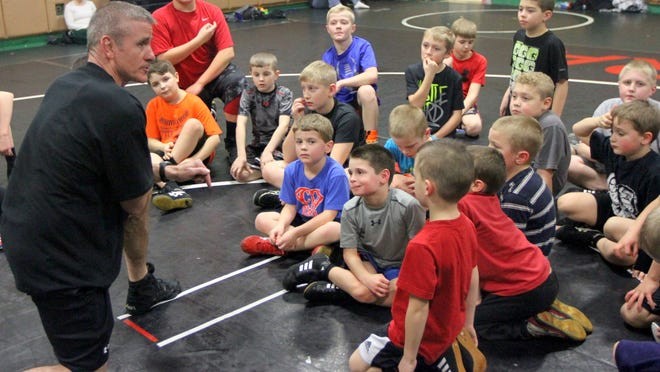 Elmira Junior Wrestling Club head coach Gregg Dille talks to his wrestlers before a workout at Elmira High School on Feb. 10.