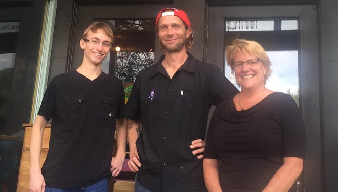 Brandon Bonebrake is shown Thursday outside the Lake Street Cafe in Elkhart Lake with chef Victor and owner Lynn Shovan. He was presented with a certificate for two years tuition at UW-Sheboygan by Make-A-Wish Wisconsin.