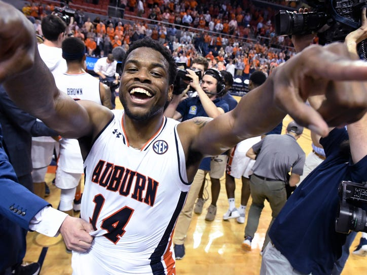 Auburn guard Malik Dunbar celebrates on the court after Auburn defeated Alabama 90-71 in an NCAA college basketball game Wednesday, Feb. 21, 2018, in Auburn, Ala. (AP Photo/John Amis)