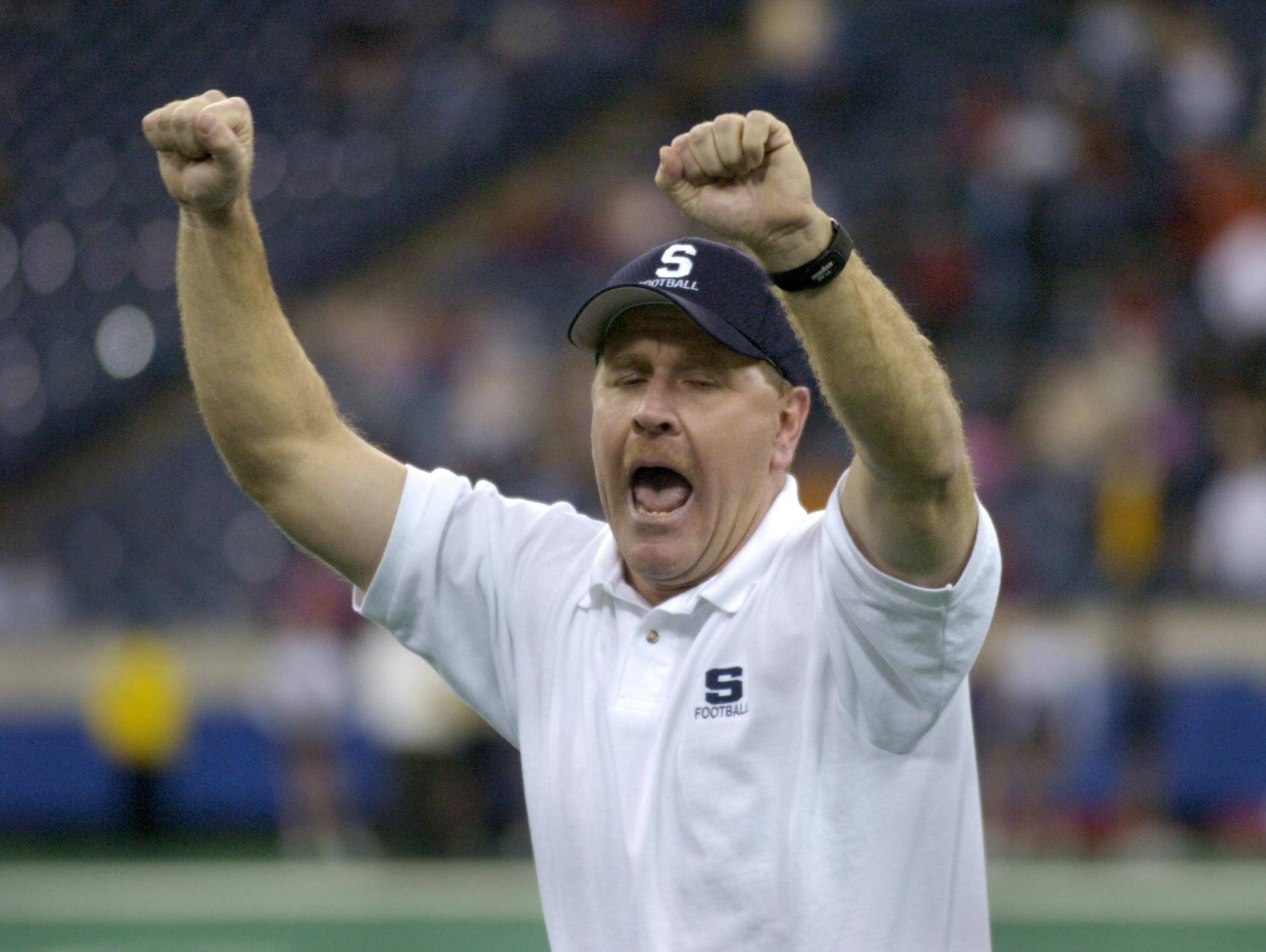 Brian Moore, then with Seeger, celebrates his team's 20-7 victory over Cardinal Ritter High School in the IHSAA Class 1A football finals in November 2004.Indianapolis Star 11/26/04--w/story--WHS1A27--Seeger High School's head football coach Brian Moore celebrates his team's 20-7 victory over Cardinal Ritter High School in the IHSAA Class 1A football finals at the RCA Dome in Indianapolis Friday Nov. 26. Staff Photo by Joe Vitti File #106037