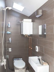 In the bathroom, the Incinolet toilet uses electric heat to turn human waste to ash to be thrown out.