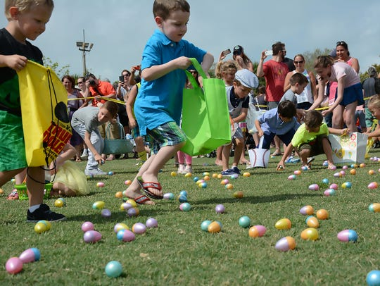 File: Four to five-year-olds head out to start scooping up plastic Easter eggs during the for the Spring Jubilee.