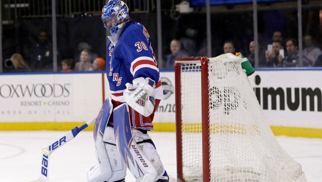 Rangers goalie Henrik Lundqvist reacts after slamming his stick into the goal and breaking it during the third period of the NHL hockey game against the Columbus Blue Jackets, Sunday, Feb. 26, 2017, in New York. The Blue Jackets defeated the Rangers 5-2.