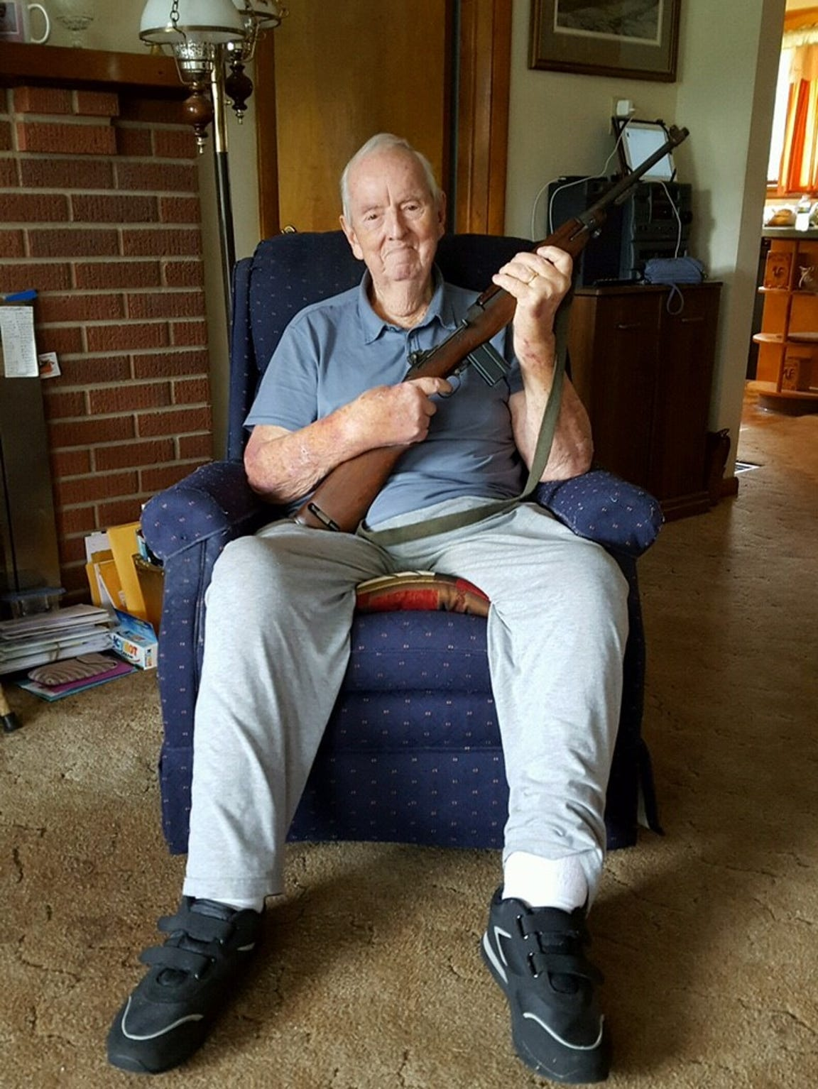 Glenn Mounts holding a World War II-era carbine in