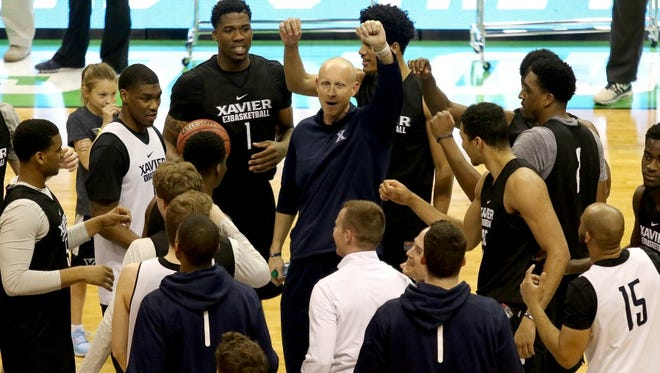 Xavier head coach Chris Mack gathers his team during Thursday's practice at the Scottrade Center in St. Louis.