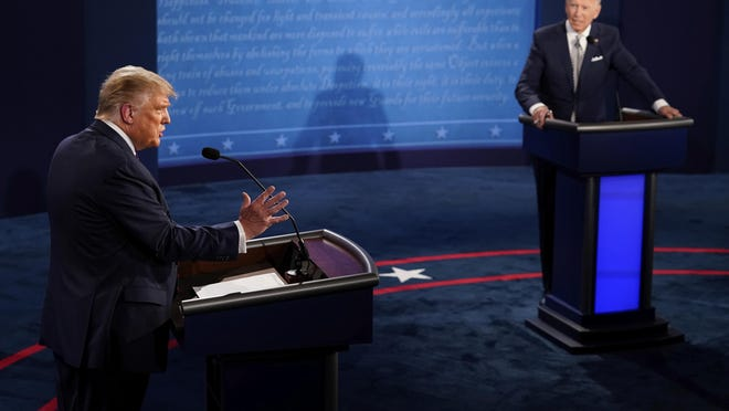 President Donald Trump answers a question as Democratic presidential candidate former Vice President Joe Biden listens during the first presidential debate Tuesday, Sept. 29, 2020, at Case Western University and Cleveland Clinic, in Cleveland, Ohio.