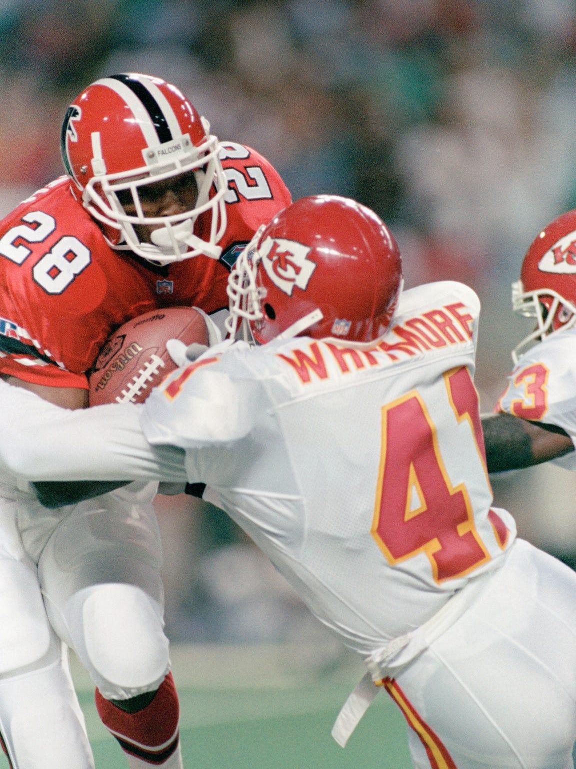 Atlanta Falcons running back Tony Smith is hit by Kansas City Chiefs safety David Whitmore on the opening kickoff on Sept. 18, 1994 in Atlanta.
