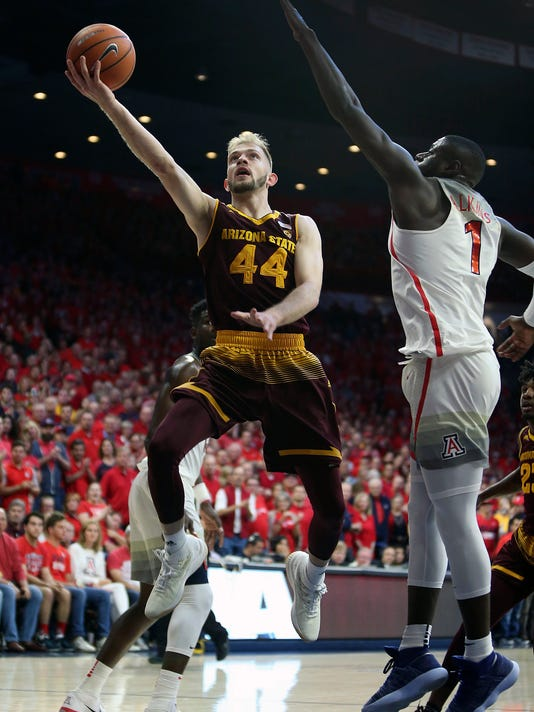 Arizona State guard Kodi Justice (44) drives to the basket past the defense of Arizona's Rawle Alkins (1) during the first half of an NCAA college basketball game, Saturday, Dec. 30, 2017, in Tucson, Ariz. (AP Photo/Ralph Freso)