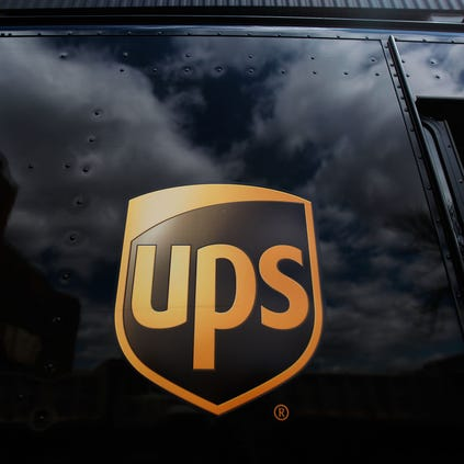 The United Parcel Service logo is emblazoned on the side of a delivery truck.