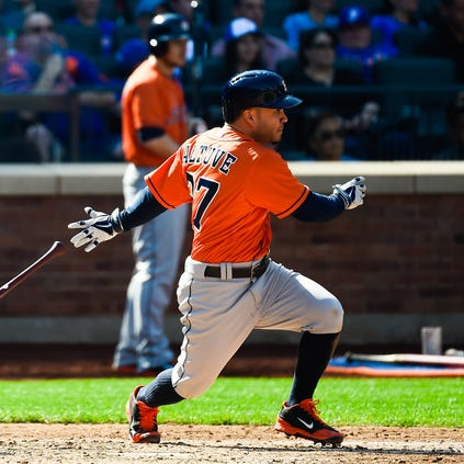 NEW YORK, NY - SEPTEMBER 28: Jose Altuve #27 of the Houston Astros singles in the fifth inning against the New York Mets at Citi Field on September 28, 2014 in the Flushing neighborhood of the Queens borough of New York City.  (Photo by Alex Goodlett/Getty Images)