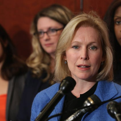 Sen. Kristen Gillibrand (D-NY) is joined by survivors of campus sexual assult during a news conference about new legislation aimed at curbing sexual assults on college and university campuses at the U.S. Capitol Visitors Center July 30, 2014 in Washington, DC. With strong bipartisan support in the Senate, the bill would require schools to make public the result of anonymous surveys about campus assaults and impose significant financial burdens on universities that fail to comply with some of the law's requirements.  (Photo by Chip Somodevilla/Getty Images)
