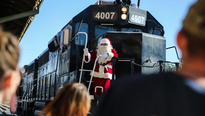 Santa arrives for the Santa's Santa Fe Christmas Saturday, Nov. 25, 2017, at the Railway Museum of San Angelo.