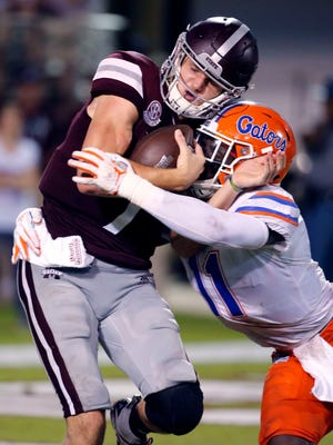 Mississippi State quarterback Nick Fitzgerald (7) is tackled for a loss by Florida linebacker Vosean Joseph (11) during the second half of an NCAA college football game in Starkville, Miss., Saturday, Sept. 29, 2018. Florida won 13-6. (AP Photo/Rogelio V. Solis)