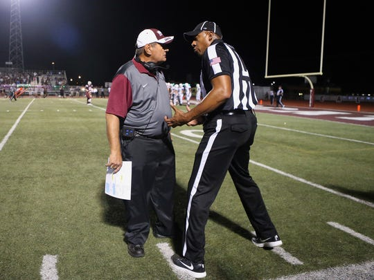 GABE HERNANDEZ/CALLER-TIMESCalallen head coach Phil Danaher talks to an official against Flour Bluff during the district 30-5A championship on Thursday Nov. 3, 2016, at Wildcat Stadium in Corpus Christi.