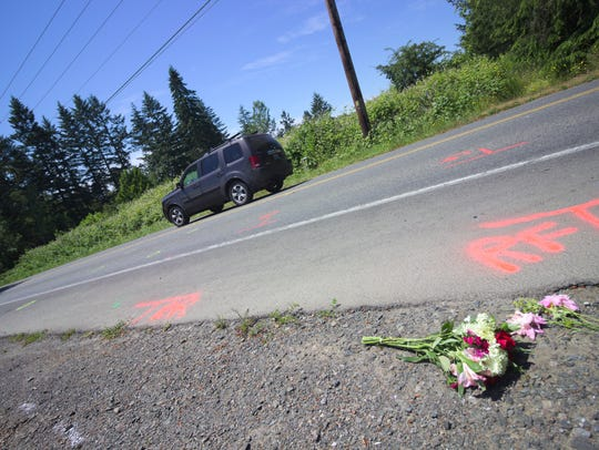 FILE PHOTO – Flowers lay along Finch Road on Bainbridge