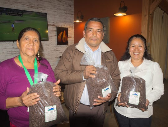 Delegates Carmen Lopez, left, Noé Gonzalez, center,
