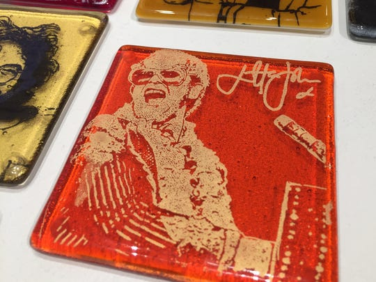 Which icon do you want to place your drink on? The coasters are at Artifacts, 6327 Guilford Ave.