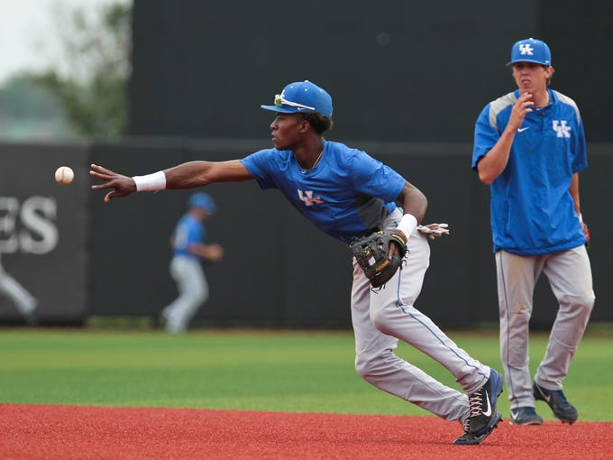 Kentucky's JaVon Shelby makes a play during practice in preparation for the Louisville NCAA Super Regional game Friday against Kansas. May 29, 2014