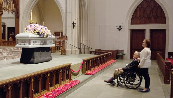 "Former President George H. W. Bush looks at the casket with his daughter Dorothy ""Doro"" Bush Koch as they wait for mourners during the April 20 visitation for former first lady Barbara Bush at St. Martin's Episcopal Church in Houston."