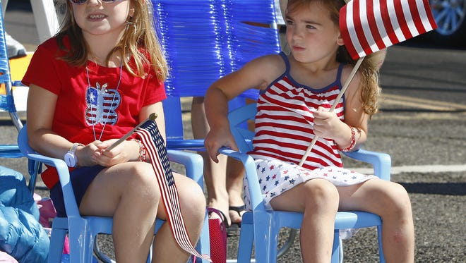 Nikki Nau, 6, left, and her sister, Ali, 4, of Sunburst watch a Fourth of July Parade. Small town all over Montana are holding their annual celebrations starting July 1.