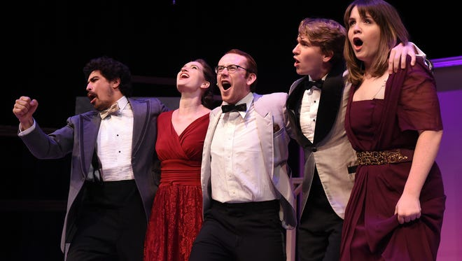 """William Joseph Bureau, Kaelin Curran, Brian Lundy, Jack Baylis, and Kelsey McCollaum sing during a rehearsal for Weathervane Playhouse's production of """"Merrily We Roll Along"""". The Stephen Sondheim musical follows the story of three friends through each milestone of their personal and professional lives beginning in the present and moving backwards in time. The show opens on Thursday, July 19, with shows through the 28th."""