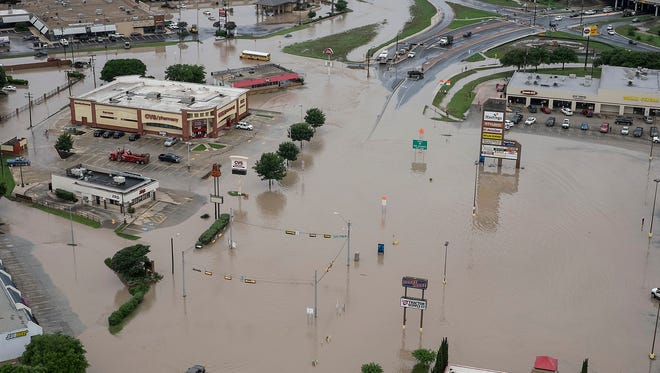A shopping center in San Marcos, Texas, is swamped by flooding from the Blanco River on Sunday.
