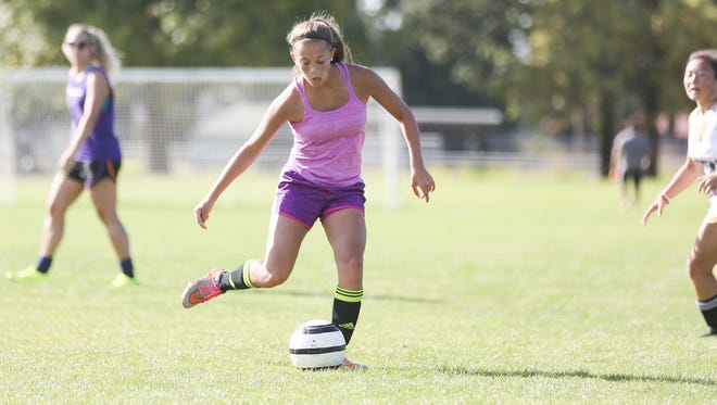 Junior Brooklynn Petterson passes to a teammate during a Cascade High School soccer practice on Monday, Aug. 29, 2016, in Turner, Ore. Petterson also competes with the school's wrestling team, placing sixth in the 106-pound weight class at the 4A Special District 2 tournament.