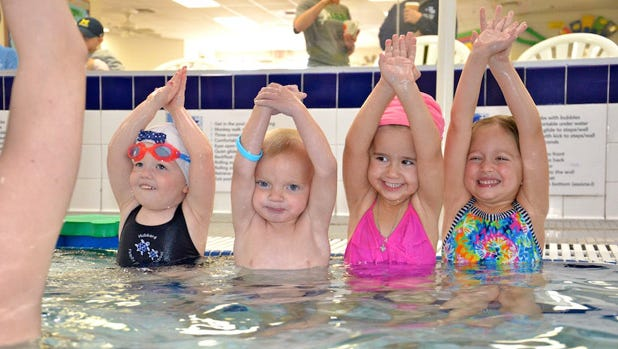 Kids as young as 30 months can enjoy swim lessons at Hubbard Family Swim in Mesa starting May 18, 2015.