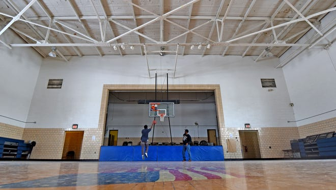 Xavier Huddleston and Terre Carter play basketball Thursday afternoon in the Ocie Hill gymnasium. The community center is offering open gyms for the public to attract more people to the facility.