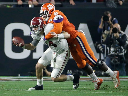 Clemson's Shaq Lawson, right, sacks Alabama's Jake Coker during the first half of the NCAA college football playoff championship game Monday, Jan. 11, 2016, in Glendale, Ariz.