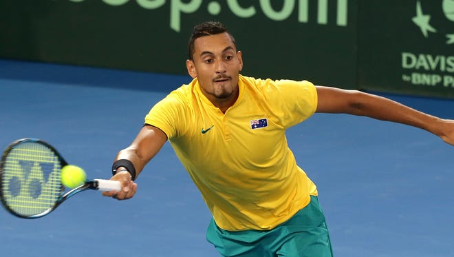 Nick Kyrgios of Australia plays a shot in his match against John Isner of the U.S. at the Davis Cup world group quarterfinal.