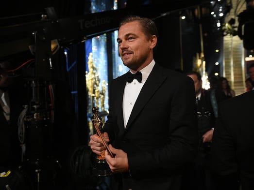 Leonardo DiCaprio walks backstage after accepting Best