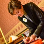 """Lt. Governor Kim Reynolds autographs copies of """"Green Eggs & Ham"""" on Wednesday, March 2, 2016, during Iowa Egg Council's reading with Capitol View Elementary at the State Capitol."""