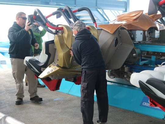 Tom Kaufman and Ted Brubaker, inspectors with the Ohio Department of Agriculture, demonstrate the ride inspection process on the GateKeeper at Cedar Point.